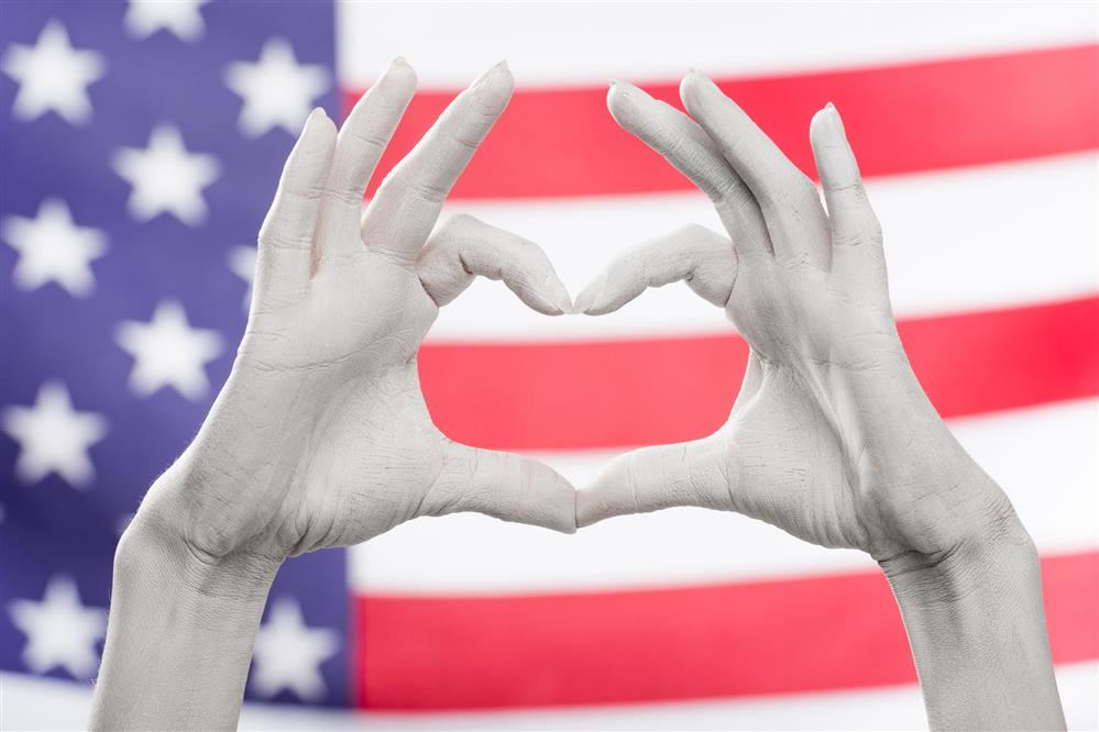 Heart hands in front of American flag